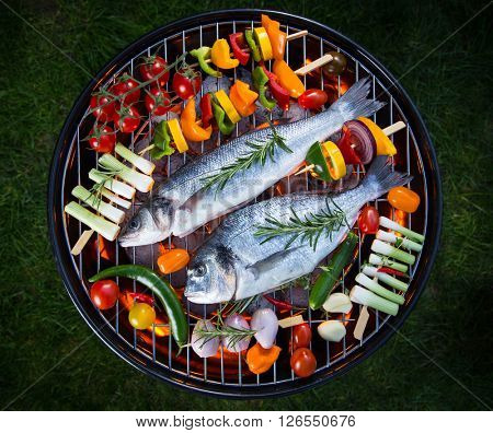 Barbecue grill with various kinds of sea fishes.