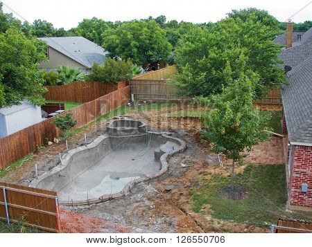 View of Outdoor swimming pool under construction.