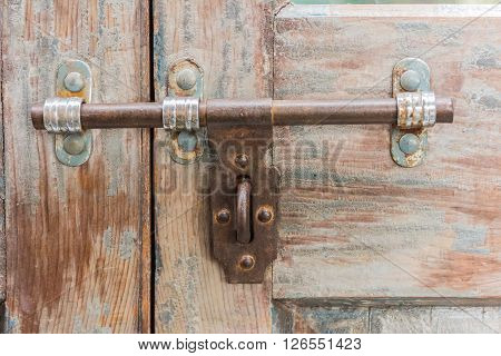 The Old latch on a wooden door