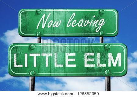 Now leaving little elm road sign with blue sky