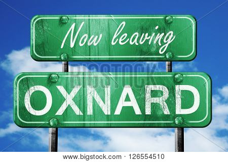 Now leaving oxnard road sign with blue sky