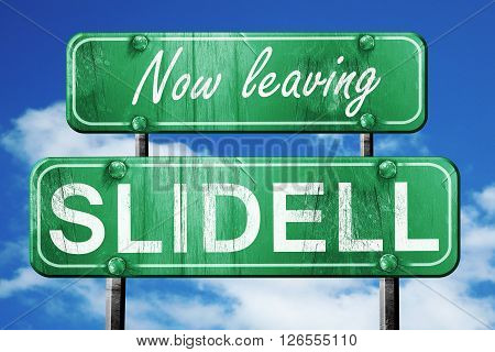 Now leaving slidell road sign with blue sky