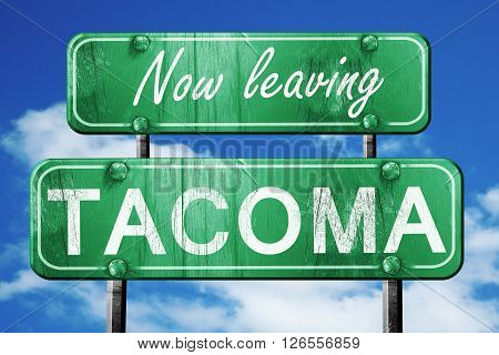 Now leaving tacoma road sign with blue sky