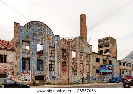 KOTOR MONTENEGRO - AUGUST 30 2009: An abandoned factory that sustained major damage after the 1979 earthquake