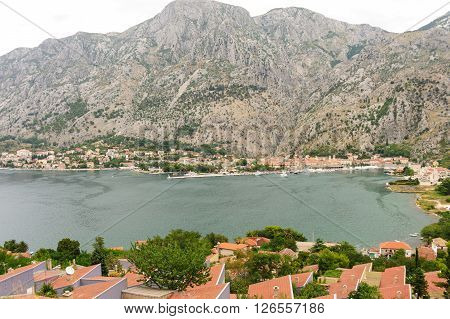 KOTOR, MONTENEGRO - AUGUST 30, 2009: Cityscape of Kotor and Dobrota from Muo across the bay