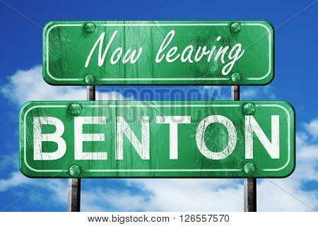 Now leaving benton road sign with blue sky