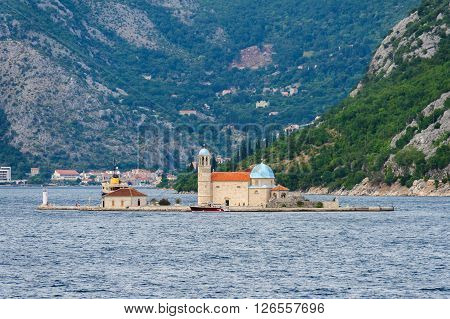 BAY OF KOTOR, MONTENEGRO - AUGUST 30, 2009: Artificial islet of Our Lady of the Rocks off the coast of Perast in the Bay of Kotor