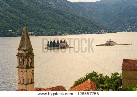 BAY OF KOTOR, MONTENEGRO - AUGUST 30, 2009: Islets of St. George and Our Lady of the Rocks off the coast of Perast in the Bay of Kotor