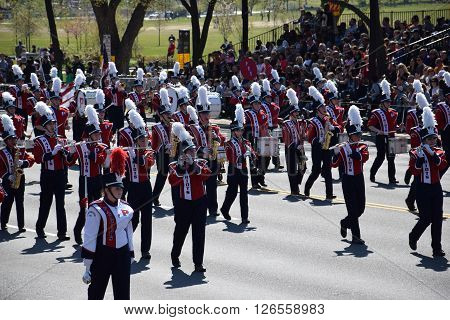 WASHINGTON, DC - APR 16: Marching band at the 2016 National Cherry Blossom Parade in Washington DC, as seen on April 16, 2016. Thousands of visitors gathered to attend this annual event.