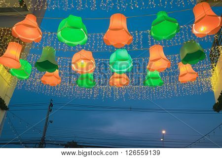 Orange and green beautiful lamp outdoor outside shopping mall night bazaar with electricity post and cable/Beautiful lamp outside shopping mall night bazaar ** Note: Visible grain at 100%, best at smaller sizes