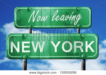 Now leaving new york road sign with blue sky