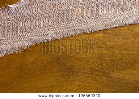 White gauze bandage on a wooden background