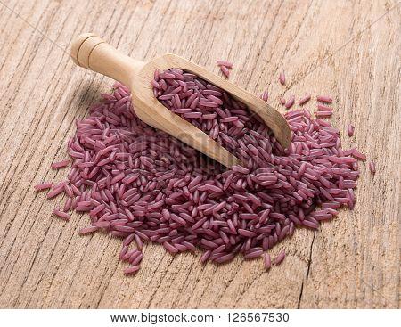 Closeup Purple rice on wooden background. rice