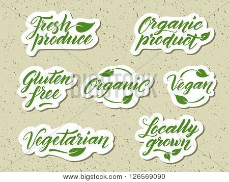 Hand drawn healthy food letterings. Label, logo template against recycled paper background. Organic, organic product, gluten free, vegan, locally grown, vegetarian, fresh produce.