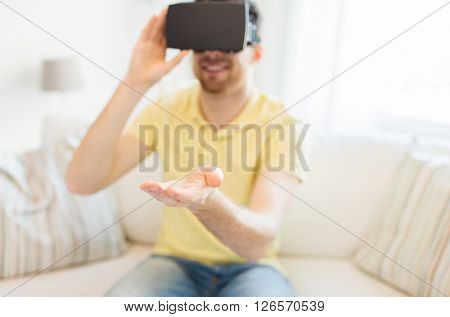 3d technology, virtual reality, gaming, entertainment and people concept - close up of young man with virtual reality headset or 3d glasses playing videogame at home