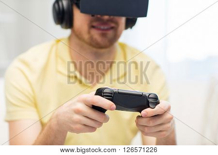 3d technology, virtual reality, gaming, entertainment and people concept - close up of man with virtual reality headset or 3d glasses and headphones playing video game with controller gamepad at home