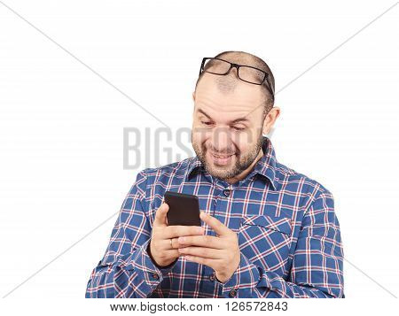 Caucasian Man Typing A Message On Mobile Phone.