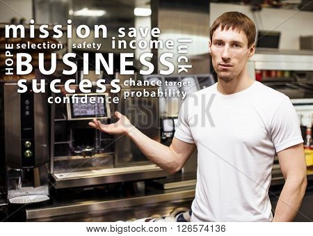 Portrait of worker in coffeeshop shows equipment and words cloud