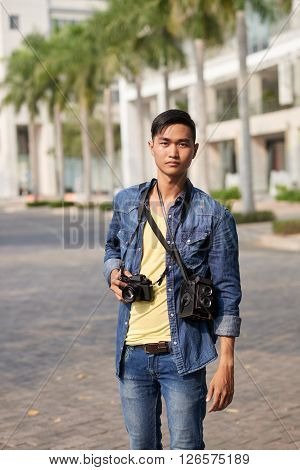 Portrait of professional photographer standing on the street