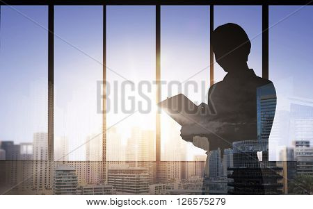 business, building, architecture, industry and people concept - silhouette of woman with clipboard over double exposure office and city background
