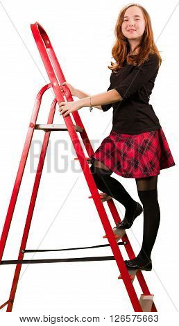 Beaytiful teen girl in checkered skirt standing on stepladder