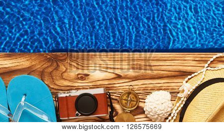 Travel and beach items at pool