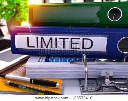 Blue Office Folder with Inscription Limited on Office Desktop with Office Supplies and Modern Laptop. Limited Business Concept on Blurred Background. Limited - Toned Image. 3D.