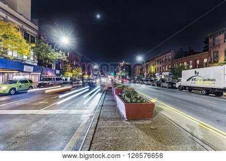 Night View In Brooklyn Of Main Street With Headlights Of Cars