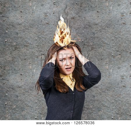 Young woman with a headache and burning fire
