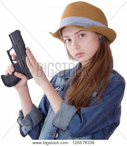 Pretty teen girl with a gun on white background