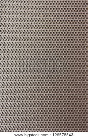 The surface hole of a cap used to decorate the front of the TV speakers.