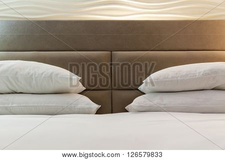Set up brown bed with white linen in a hotel closeup