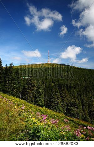 Fresh scenery of the hills with transmitter and blue cloudy sky