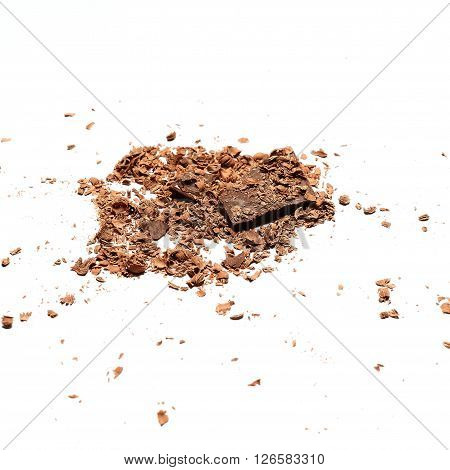 Pieces of the chocolate covered by the laminae and shavings