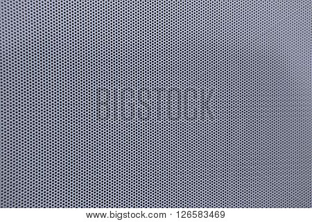 White perforated sheep with little holes and  blurred margins