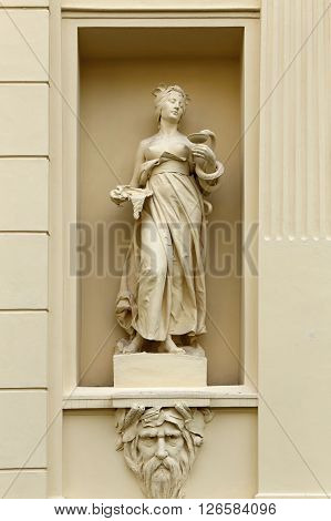Scuplture of the young lady with the snake and bowl in the embrasure