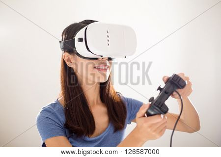 Woman play with joystick and VR device