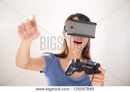Woman play video game with virtual reality device