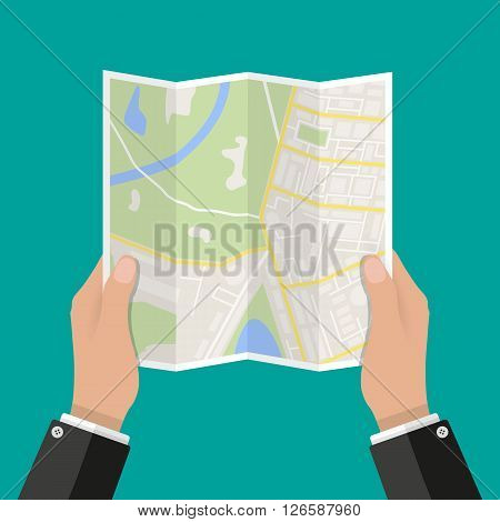 Folded Paper Map In Hand, Abstract generic city map with roads, buildings, parks, river. Vector Illustration in flat design on green background