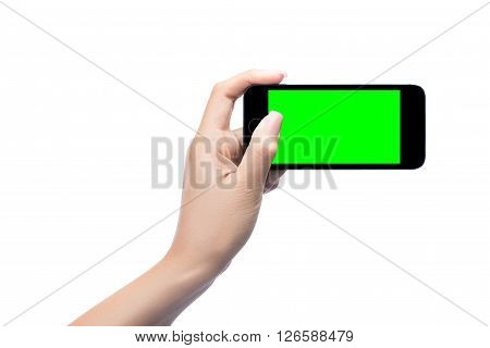 Woman Hand Holding Mobile Smart Phone With Green Screen Isolated On White Clipping Path.