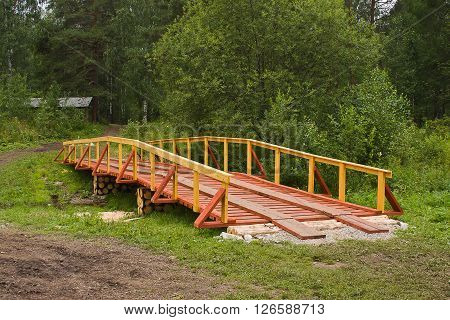New Wooden Bridge In Field
