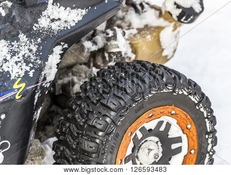 Wheel of radio-controlled model car close-up in snow ** Note: Visible grain at 100%, best at smaller sizes
