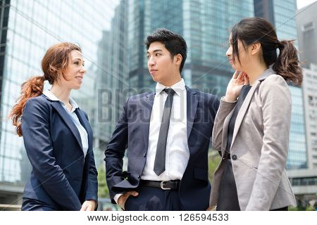 Business people talking to colleagues