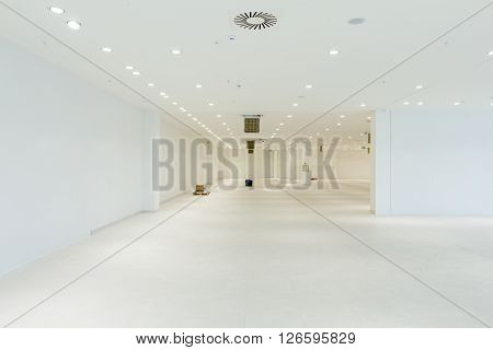 Interior of empty unfinished modern mega market. Architecture concept. Empty white room has white walls.