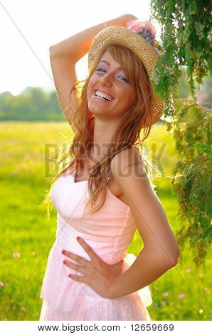 Sexy Young Girl Smiling On Sunset Yellow Background
