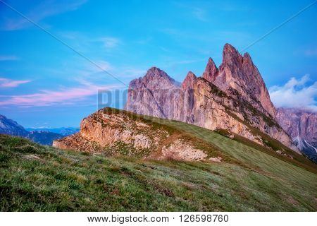 Fantastic views of the magical place Funes Valley. Dramatic and picturesque scene.  Location famous resort Puez Odle National Park, Dolomiti, Seceda, South Tyrol. Italian alps, Europe. Beauty world.
