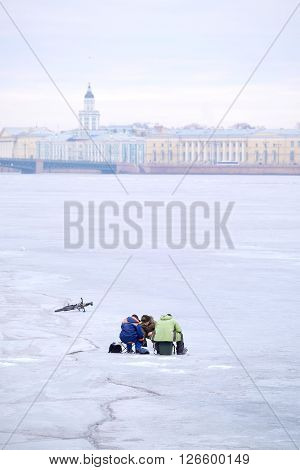 Fisherman on an ice of Neva river in St. Petersburg, Russia.