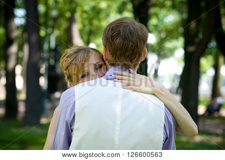 Happy couple in love looking deeply into each others eyes, touching foreheads