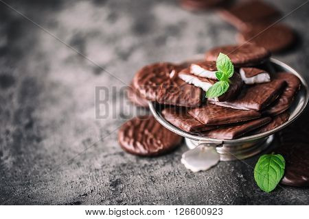 Chocolate peppermint cookies.Mint. Peppermint. Menthol. Black chocolate with peppermint cream. Black chocolate with mint stuffing. Menthol chocolate with mint leaves. Toned images.