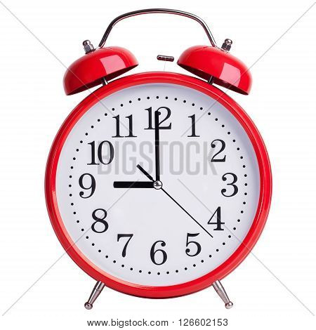 Round red alarm clock shows exactly nine o'clock